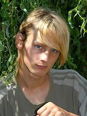 Naked blonde teen boy posing in the garden